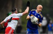 4 October 2020; Ciaran O'Ferraigh of Ratoath in action against James Reilly of Gaeil Colmcille during the Meath County Senior Football Championship Final match between Ratoath and Gaeil Colmcille at Páirc Táilteann in Navan, Meath. Photo by Brendan Moran/Sportsfile