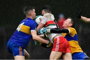 4 October 2020; Seamus Mattimoe of Gaeil Colmcille is tackled by Ben Wyer, left, and Shane Duffy of Ratoath, resulting in a penalty during the Meath County Senior Football Championship Final match between Ratoath and Gaeil Colmcille at Páirc Táilteann in Navan, Meath. Photo by Brendan Moran/Sportsfile