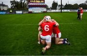 4 October 2020; St Thomas players, from left, Fintan Burke, Shane Cooney and Evan Duggan celebrate following the Galway County Senior Hurling Championship Final match between Turloughmore and St Thomas at Kenny Park in Athenry, Galway. Photo by David Fitzgerald/Sportsfile
