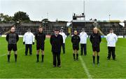 4 October 2020; Referee Administrator Frank Gallogly and referee David Coldrick with match officials Stephen Dawson, Kieran Olwell and Cormac Reilly and umpires Ronan Garry, Stephen O'Hare, Pat Darby and Joseph Curran socially distanced prior to the Meath County Senior Football Championship Final match between Ratoath and Gaeil Colmcille at Páirc Táilteann in Navan, Meath. Photo by Brendan Moran/Sportsfile
