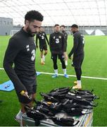 5 October 2020; Derrick Williams picks his GPS device during an activation session prior to a Republic of Ireland training session at the Sport Ireland National Indoor Arena in Dublin.  Photo by Stephen McCarthy/Sportsfile