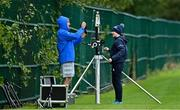 6 October 2020; Senior performance analyst Brian Colclough, left, and performance analyst Juliett Fortune set up their equipment prior to Leinster Rugby squad training at UCD in Dublin. Photo by Brendan Moran/Sportsfile