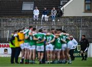 3 October 2020; Spectators look on from outside the ground as Moorefield players huddle at half-time during the Kildare County Senior Football Championship Final match between Moorefield and Athy at St Conleth's Park in Newbridge, Kildare. Photo by Piaras Ó Mídheach/Sportsfile