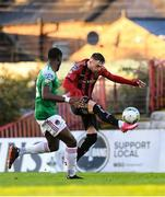 9 October 2020; Danny Grant of Bohemians shoots to score his side's second goal despite the attentions of Joseph Olowu of Cork City during the SSE Airtricity League Premier Division match between Bohemians and Cork City at Dalymount Park in Dublin. Photo by Matt Browne/Sportsfile