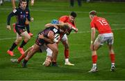 10 October 2020; Pierre Schoeman of Edinburgh is tackled by Tadhg Beirne, left, and Conor Murray of Munster during the Guinness PRO14 match between Munster and Edinburgh at Thomond Park in Limerick. Photo by Ramsey Cardy/Sportsfile