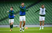 11 October 2020; Shane Long of Republic of Ireland, centre, warms-up alongside team-mates Robbie Brady, left, and Jeff Hendrick prior to the UEFA Nations League B match between Republic of Ireland and Wales at the Aviva Stadium in Dublin. Photo by Seb Daly/Sportsfile