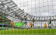 11 October 2020; Shane Long of Republic of Ireland heads over under pressure from Wales goalkeeper Wayne Hennessey during the UEFA Nations League B match between Republic of Ireland and Wales at the Aviva Stadium in Dublin. Photo by Seb Daly/Sportsfile