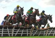 14 October 2020; Eskylane, left, with Keith Donoghue up, jumps the first alongside Highstreet Roller, centre, with Darragh O'Keeffe up, who finished fifth, and Gabynako, with Conor Maxwell up, who finished second, on their way to winning the Sherry Fitzgerald Brady O'Flaherty Maiden Hurdle at Punchestown Racecourse in Kildare. Photo by Seb Daly/Sportsfile