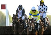 14 October 2020; Zarkareva, left, with Dylan Robinson up, jumps the last alongside eventual second place Polished Steel, centre, with Sean O'Keeffe up, on their way to winning the Idealgraphix.ie Branding Irish Racecourses Novice Steeplechase at Punchestown Racecourse in Kildare. Photo by Seb Daly/Sportsfile
