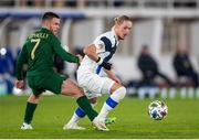 14 October 2020; Fredrik Jenson of Finland is tackled by Aaron Connolly of Republic of Ireland during the UEFA Nations League B match between Finland and Republic of Ireland at Helsingin Olympiastadion in Helsinki, Finland. Photo by Mauri Forsblom/Sportsfile