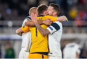 14 October 2020; Finland players, from left, Paulus Arajuuri, goalkeeper Lukas Hredecky and Joona Toivio celebrate following their victory in the UEFA Nations League B match between Finland and Republic of Ireland at Helsingin Olympiastadion in Helsinki, Finland. Photo by Mauri Forsblom/Sportsfile