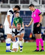 14 October 2020; Paulus Arajuuri, centre, with Finland team-mate Tim Sparv, left, and referee Lionel Tschudi during the UEFA Nations League B match between Finland and Republic of Ireland at Helsingin Olympiastadion in Helsinki, Finland. Photo by Mauri Fordblom/Sportsfile