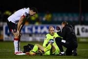16 October 2020; Dundalk goalkeeper Gary Rogers receives treatment from physiotherapist Danny Miller, right, as team-mate Brian Gartland looks on during the SSE Airtricity League Premier Division match between Dundalk and Bohemians at Oriel Park in Dundalk, Louth. Photo by Harry Murphy/Sportsfile