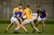 17 October 2020; Andy Maher, supported by Paddy O'Keane, right, of Wicklow in action against Peter Healy, 7, and Conor Murray of Antrim during the Allianz Football League Division 4 Round 6 match between Wicklow and Antrim at the County Grounds in Aughrim, Wicklow. Photo by Ray McManus/Sportsfile