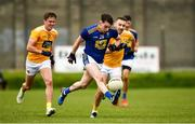 17 October 2020; Conor Byrne of Wicklow in action against Eoin Nagle, left, and Kevin Quinn of Antrim during the Allianz Football League Division 4 Round 6 match between Wicklow and Antrim at the County Grounds in Aughrim, Wicklow. Photo by Ray McManus/Sportsfile