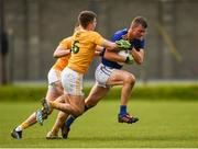 17 October 2020; Rory Finn of Wicklow in action against James McAuley, 6, and Kevin Quinn of Antrim during the Allianz Football League Division 4 Round 6 match between Wicklow and Antrim at the County Grounds in Aughrim, Wicklow. Photo by Ray McManus/Sportsfile