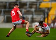 17 October 2020; Kevin O'Driscoll of Cork in action against Fergal Donohue of Louth during the Allianz Football League Division 3 Round 6 match between Cork and Louth at Páirc Ui Chaoimh in Cork. Photo by Harry Murphy/Sportsfile