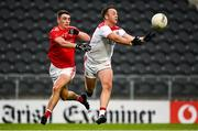 17 October 2020; Paul Kerrigan of Cork in action against Emmet Carolan of Louth during the Allianz Football League Division 3 Round 6 match between Cork and Louth at Páirc Ui Chaoimh in Cork. Photo by Harry Murphy/Sportsfile