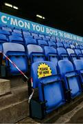17 October 2020; A general view of social distance signage on a seat ahead of the Allianz Football League Division 1 Round 6 match between Dublin and Meath at Parnell Park in Dublin. Photo by Ramsey Cardy/Sportsfile