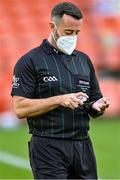 17 October 2020; Referee David Gough, wearing a face mask, applies hand sanitiser before the coin toss at the Allianz Football League Division 2 Round 6 match between Armagh and Roscommon at the Athletic Grounds in Armagh. Photo by Piaras Ó Mídheach/Sportsfile