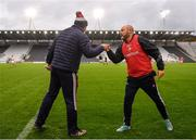 17 October 2020; Cork manager Ronan McCarthy and Louth manager Wayne Kierans fist bump following the Allianz Football League Division 3 Round 6 match between Cork and Louth at Páirc Ui Chaoimh in Cork. Photo by Harry Murphy/Sportsfile