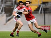 17 October 2020; Eoghan McSweeney of Cork in action against Dermot Campbell of Louth during the Allianz Football League Division 3 Round 6 match between Cork and Louth at Páirc Ui Chaoimh in Cork. Photo by Harry Murphy/Sportsfile