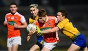 17 October 2020; Oisín O'Neill of Armagh in action against Cathal Compton, left, and David Murray of Roscommon during the Allianz Football League Division 2 Round 6 match between Armagh and Roscommon at the Athletic Grounds in Armagh. Photo by Piaras Ó Mídheach/Sportsfile