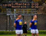 17 October 2020; Referee John Hickey and Wicklow players Seanie Furlong, left, and Niall Donnelly stand during the playing of Amhrán na bhFiann before the Allianz Football League Division 4 Round 6 match between Wicklow and Antrim at the County Grounds in Aughrim, Wicklow. Photo by Ray McManus/Sportsfile