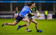 17 October 2020; Cathal Hickey of Meath is tackled by Robert McDaid of Dublin during the Allianz Football League Division 1 Round 6 match between Dublin and Meath at Parnell Park in Dublin. Photo by Brendan Moran/Sportsfile