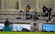 17 October 2020; eirsport match commentary team, from left, co-commentator Marty Clarke, commentator Mike Finnerty and analyst Joe Brolly watch from their positions during the Allianz Football League Division 1 Round 6 match between Dublin and Meath at Parnell Park in Dublin. Photo by Brendan Moran/Sportsfile