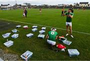 18 October 2020; Mayo players Matthew Ruane, 8, and Fionn McDonagh prepare for the match with their individual boxes during the Allianz Football League Division 1 Round 6 match between Galway and Mayo at Tuam Stadium in Tuam, Galway. Photo by Ramsey Cardy/Sportsfile