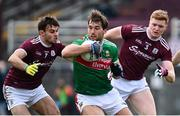 18 October 2020; Aidan O'Shea of Mayo in action against Cillian McDaid, left, and Séan Andy Ó Ceallaigh of Galway during the Allianz Football League Division 1 Round 6 match between Galway and Mayo at Tuam Stadium in Tuam, Galway. Photo by Ramsey Cardy/Sportsfile