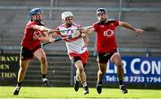 18 October 2020; Eamon McGill of Derry in action against Conor Woods, left and Tom Murray of Down during the Allianz Hurling League Division 2B Final match between Down and Derry at the Athletic Grounds in Armagh. Photo by Sam Barnes/Sportsfile
