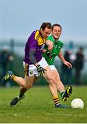 18 October 2020; Kevin O'Grady of Wexford is tackled by Darragh Treacy of Limerick during the Allianz Football League Division 4 Round 6 match between Limerick and Wexford at Mick Neville Park in Rathkeale, Limerick. Photo by Eóin Noonan/Sportsfile