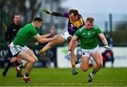18 October 2020; Kevin O'Grady of Wexford is tackled by Adrian Enright of Limerick during the Allianz Football League Division 4 Round 6 match between Limerick and Wexford at Mick Neville Park in Rathkeale, Limerick. Photo by Eóin Noonan/Sportsfile