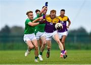 18 October 2020; Alan Tobin of Wexford is tackled by Gordon Brown of Limerick during the Allianz Football League Division 4 Round 6 match between Limerick and Wexford at Mick Neville Park in Rathkeale, Limerick. Photo by Eóin Noonan/Sportsfile