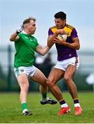 18 October 2020; Glen Malone of Wexford is tackled by Adrian Enright of Limerick during the Allianz Football League Division 4 Round 6 match between Limerick and Wexford at Mick Neville Park in Rathkeale, Limerick. Photo by Eóin Noonan/Sportsfile