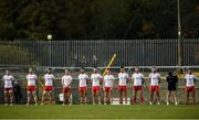 18 October 2020; Tyrone players observe a moment's silence in honour of former Tyrone goalkeeper Jonathan Curran prior to the Allianz Football League Division 1 Round 6 match between Donegal and Tyrone at MacCumhail Park in Ballybofey, Donegal. Photo by David Fitzgerald/Sportsfile