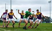 18 October 2020; Hugh Bourke of Limerick is closed down by Wexford players from left, Pa Doyle, Gavin Sheehan, Eoin Porter, Sean Ryan and Niall Hughes during the Allianz Football League Division 4 Round 6 match between Limerick and Wexford at Mick Neville Park in Rathkeale, Limerick. Photo by Eóin Noonan/Sportsfile