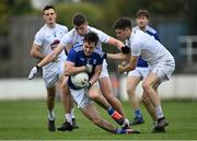 18 October 2020; Gerard Smith of Cavan is tackled by Shea Ryan and David Hyland, right, of Kildare during the Allianz Football League Division 2 Round 6 match between Kildare and Cavan at St Conleth's Park in Newbridge, Kildare. Photo by Piaras Ó Mídheach/Sportsfile
