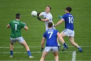 18 October 2020; Jimmy Hyland of Kildare handpasses the ball over the bar as Raymond Galligan, 1, and Oisín McKiernan of Cavan close in during the Allianz Football League Division 2 Round 6 match between Kildare and Cavan at St Conleth's Park in Newbridge, Kildare. Photo by Piaras Ó Mídheach/Sportsfile