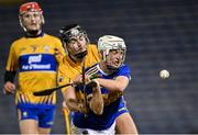 19 October 2020; Devon Ryan of Tipperary is hooked by Dylan McMahon of Clare as he prepares to shoot on goal during the Bord Gáis Energy Munster Hurling Under 20 Championship Quarter-Final match between Tipperary and Clare at Semple Stadium in Thurles, Tipperary. Photo by Piaras Ó Mídheach/Sportsfile