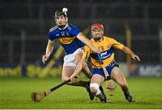 19 October 2020; Kian O'Kelly of Tipperary in action against Mike Gough of Clare during the Bord Gáis Energy Munster Hurling Under 20 Championship Quarter-Final match between Tipperary and Clare at Semple Stadium in Thurles, Tipperary. Photo by Piaras Ó Mídheach/Sportsfile