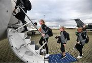 22 October 2020; Republic of Ireland players, from left, Megan Connolly, Grace Moloney and Courtney Brosnan board their charter plane at Düsseldorf International Airport ahead of the team's flight to Kiev for their UEFA Women's 2022 European Championships Qualifier against Ukraine on Friday. Photo by Stephen McCarthy/Sportsfile