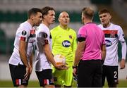 22 October 2020; Dundalk players, from left, Brian Gartland, Daniel Cleary, Gary Rogers and Sean Gannon remonstrate with referee Petri Viljanen after a penalty was awarded against their side during the UEFA Europa League Group B match between Dundalk and Molde FK at Tallaght Stadium in Dublin. Photo by Seb Daly/Sportsfile
