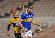 19 October 2020; Gearóid O'Connor of Tipperary is chased by Darragh Lohan of Clare during the Bord Gáis Energy Munster Hurling Under 20 Championship Quarter-Final match between Tipperary and Clare at Semple Stadium in Thurles, Tipperary. Photo by Piaras Ó Mídheach/Sportsfile