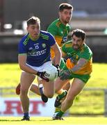 24 October 2020; Dara Moynihan of Kerry in action against Paddy McGrath and Daire O Baoill of Donegal during the Allianz Football League Division 1 Round 7 match between Kerry and Donegal at Austin Stack Park in Tralee, Kerry. Photo by Matt Browne/Sportsfile