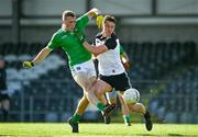 24 October 2020; Hugh Bourke of Limerick scores a point despite the attention of Eddie McGuinness of Sligo during the Allianz Football League Division 4 Round 7 match between Sligo and Limerick at Markievicz Park in Sligo. Photo by Harry Murphy/Sportsfile