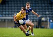 24 October 2020; Seán Mullooly of Roscommon in action against Conor Madden of Cavan during the Allianz Football League Division 2 Round 7 match between Cavan and Roscommon at Kingspan Breffni Park in Cavan. Photo by Daire Brennan/Sportsfile