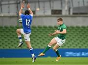24 October 2020; Garry Ringrose of Ireland kicks down field under pressure from Carlo Canna of Italy during the Guinness Six Nations Rugby Championship match between Ireland and Italy at the Aviva Stadium in Dublin. Photo by Seb Daly/Sportsfile